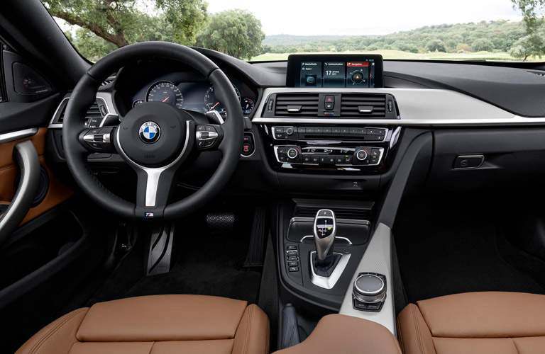 Dashboard and Brown Front Seats of 2018 BMW 4 Series