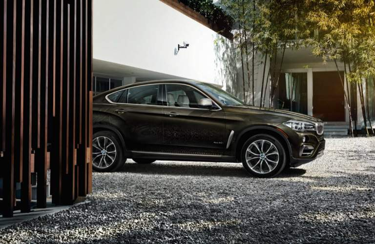 Brown 2018 BMW X6 Parked by a House