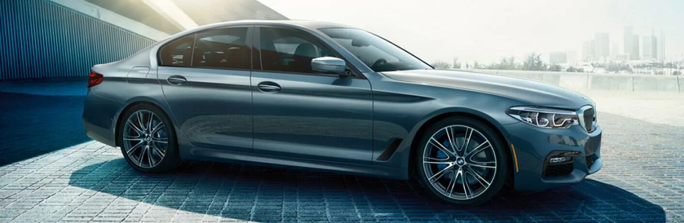 Side View of Blue 2019 BMW 5 Series