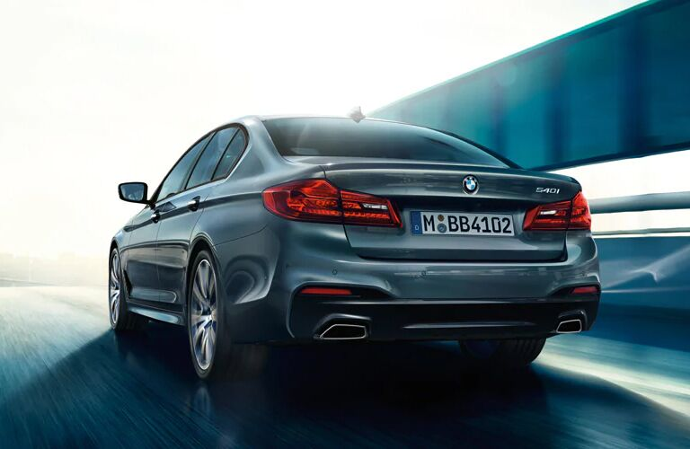 Rear View of Blue 2019 BMW 5 Series