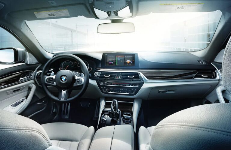 Dashboard and Front White Seats of 2019 BMW 5 Series