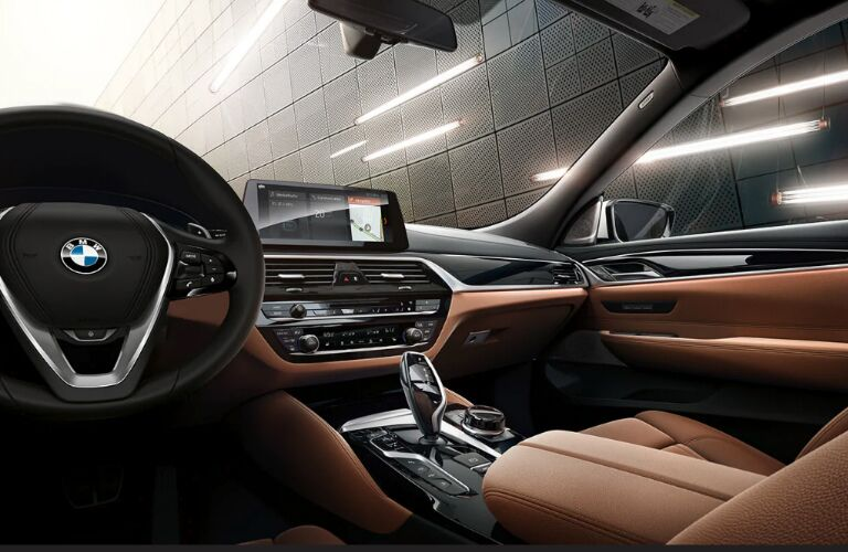 Steering Wheel, Dashboard, and Brown Front Seats in a 2019 BMW 6 Series