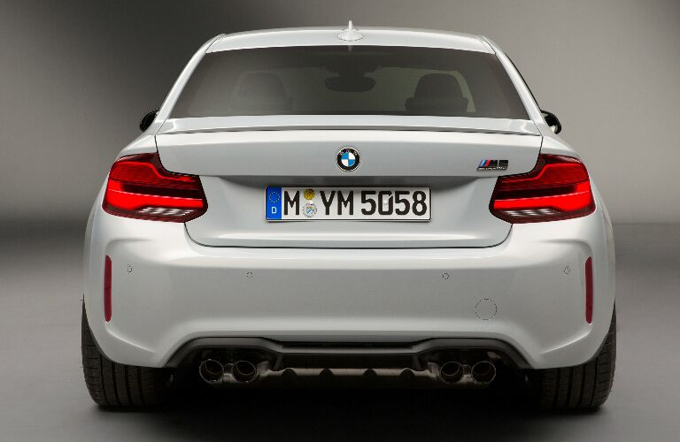 Rear View of White 2019 BMW M2 Competition