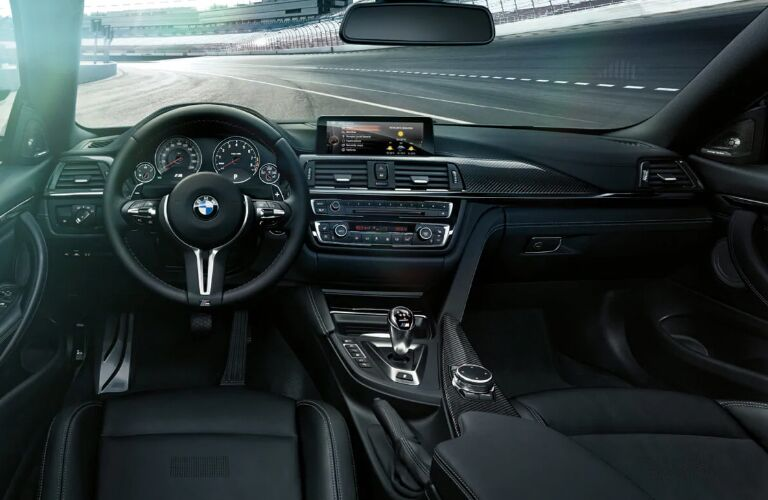Dashboard and Black Front Seats in 2019 BMW M4