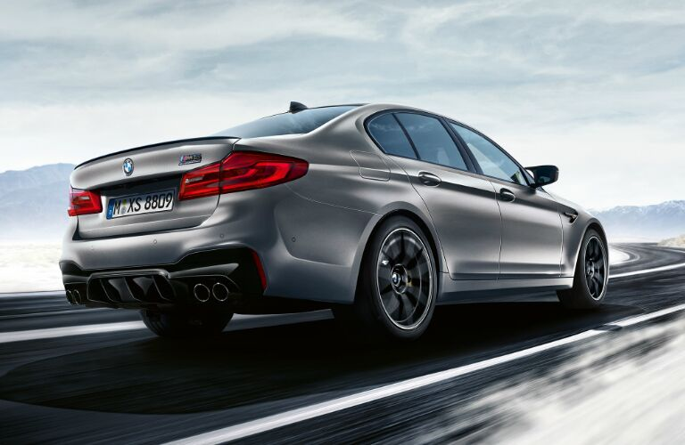 Rear View of Silver 2019 BMW M5 Competition Sedan Driving Through a Snowy Area