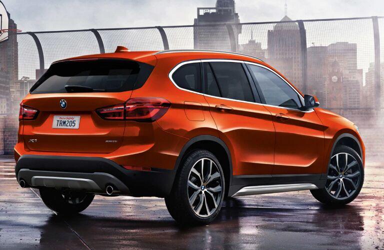 Rear view of orange 2019 BMW X1