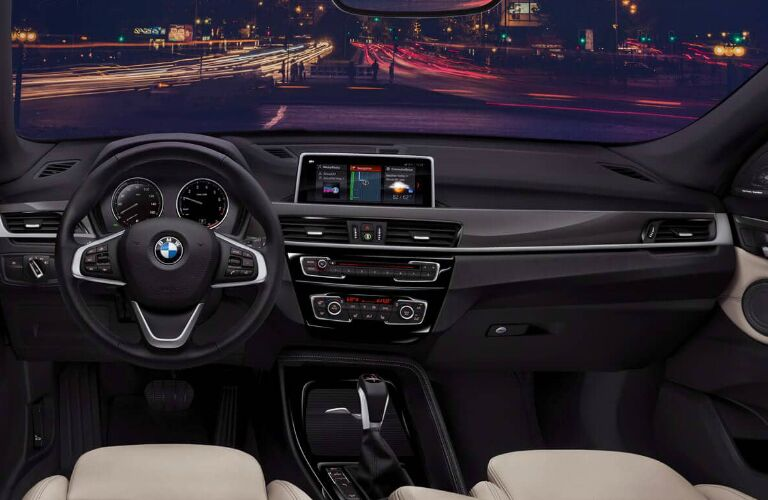Dashboard and beige front seats in 2019 BMW X1