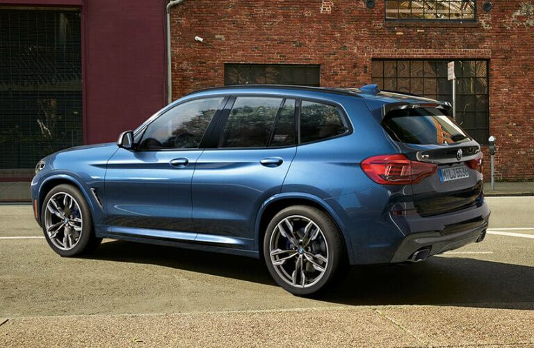 Blue 2019 BMW X3 Parked in Front of a Brick Building