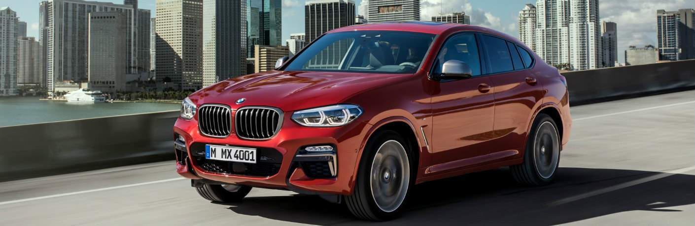 Red 2019 BMW X4 with City Skyline in the Background