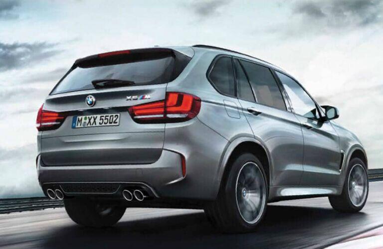 Rear view of grey 2019 BMW X5 M