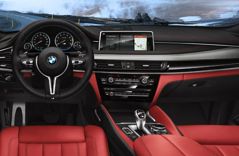 Dashboard and front red seats in 2019 BMW X5 M