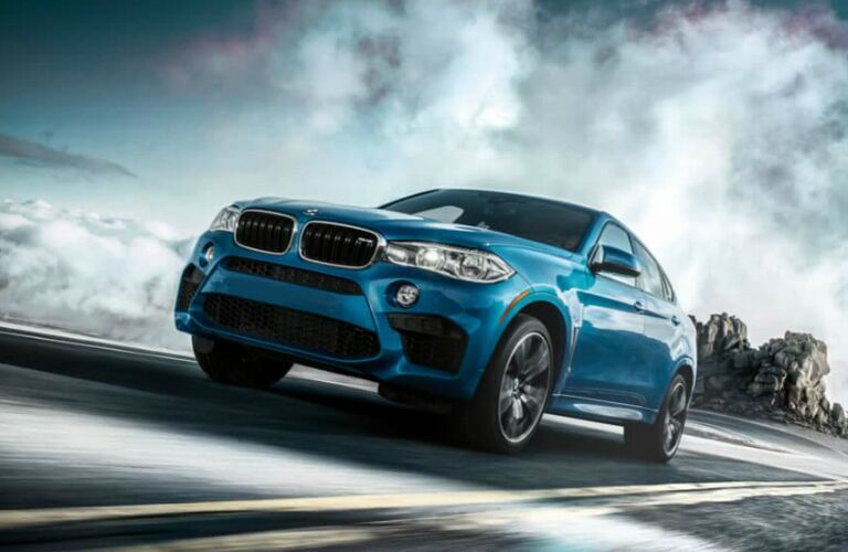 Front view of blue 2019 BMW X6 M
