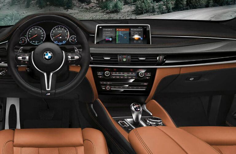 Dashboard and brown front seats in 2019 BMW X6 M