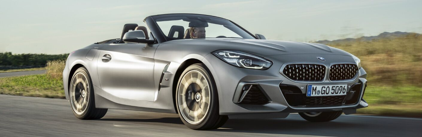 Silver 2019 BMW Z4 Roadster Driving on a Curvy Road