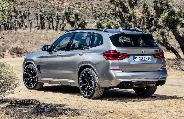 Silver 2020 BMW X3 M with Joshua trees in the background