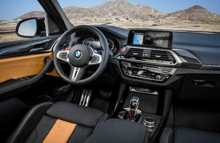 Dashboard and orange and black front seats in 2020 BMW X3 M