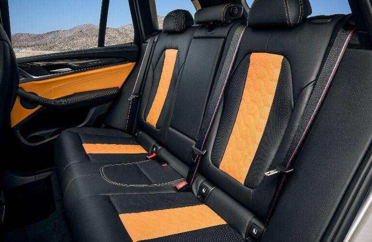 Orange and black rear seats in 2020 BMW X3 M