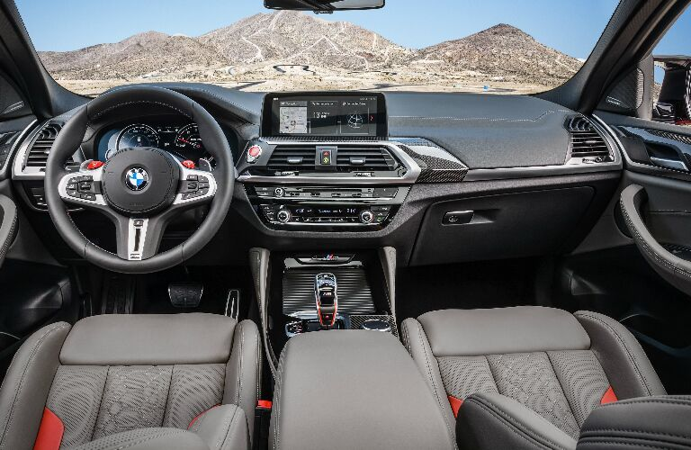 Dashboard and grey and orange front seats in 2020 BMW X4 M
