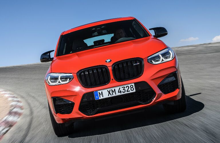 Front view of orange 2020 BMW X4 M