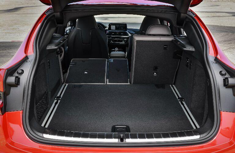 Cargo area of orange 2020 BMW X4 M