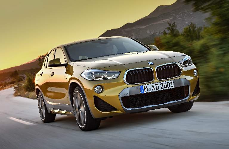 Yellow 2018 BMW X2 with Sunset in the Background