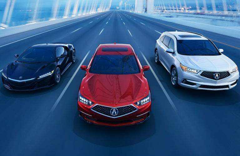 2018 Acura RLX driving with other models