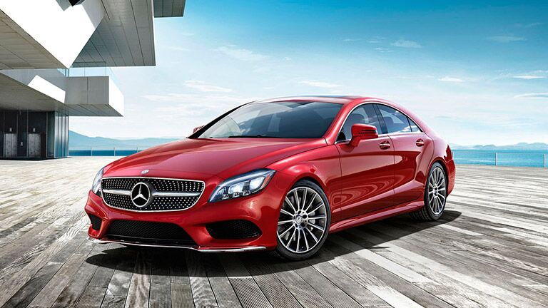 red 2016 Mercedes-Benz CLS in front of the ocean