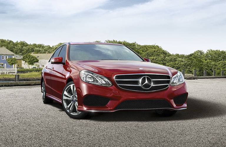 red 2016 Mercedes-Benz E-Class parked on the road with an assertive stance