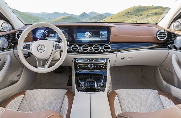 Front instrumentation of the 2017 Mercedes-Benz E-Class including steering wheel and infotainment system
