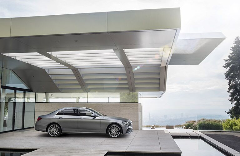 the 2017 Mercedes-Benz E-Class parked in a dramatic overhand beside what looks like a futuristic moat
