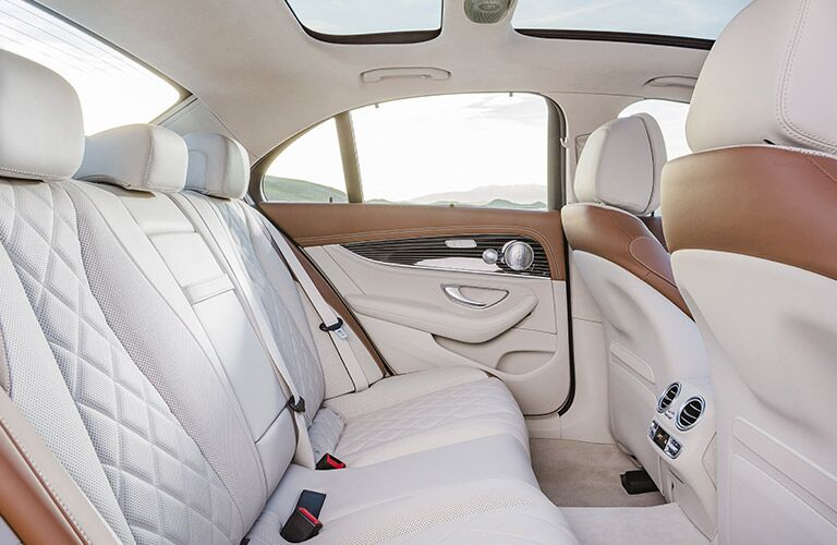 luxurious rear seating of the 2017 Mercedes-Benz E-Class in pale upholstery