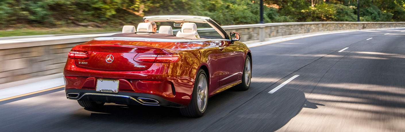 rear view of the 2018 Mercedes-Benz E-Class Cabriolet driving down the road