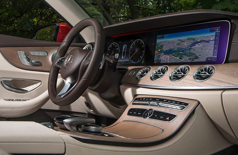 side view of the dashboard and steering wheel in the v2018 Mercedes-Benz E-Class Cabriolet