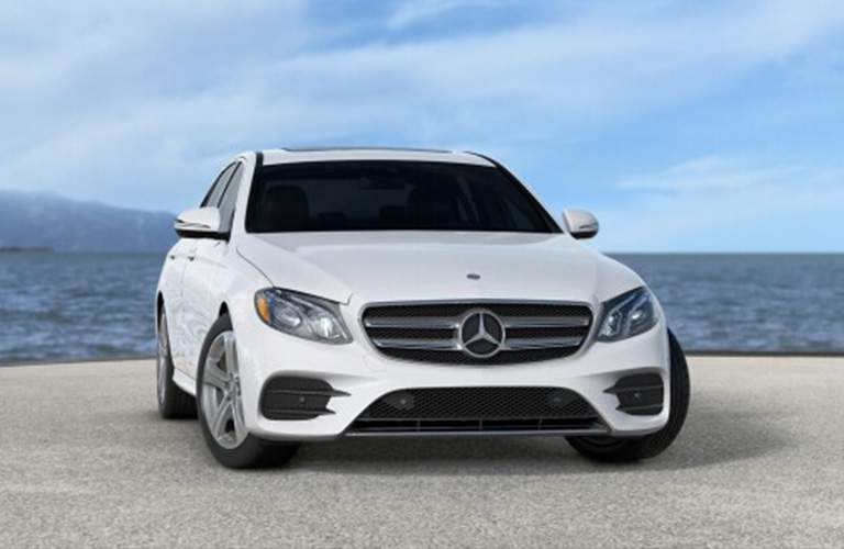 front and side view of a white 2018 Mercedes-Benz E-Class