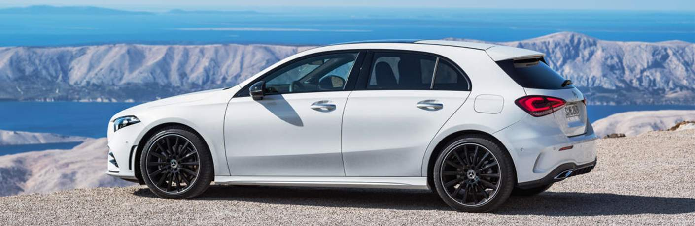 side view of a white 2019 Mercedes-Benz A-Class hatchback parked on a cliff