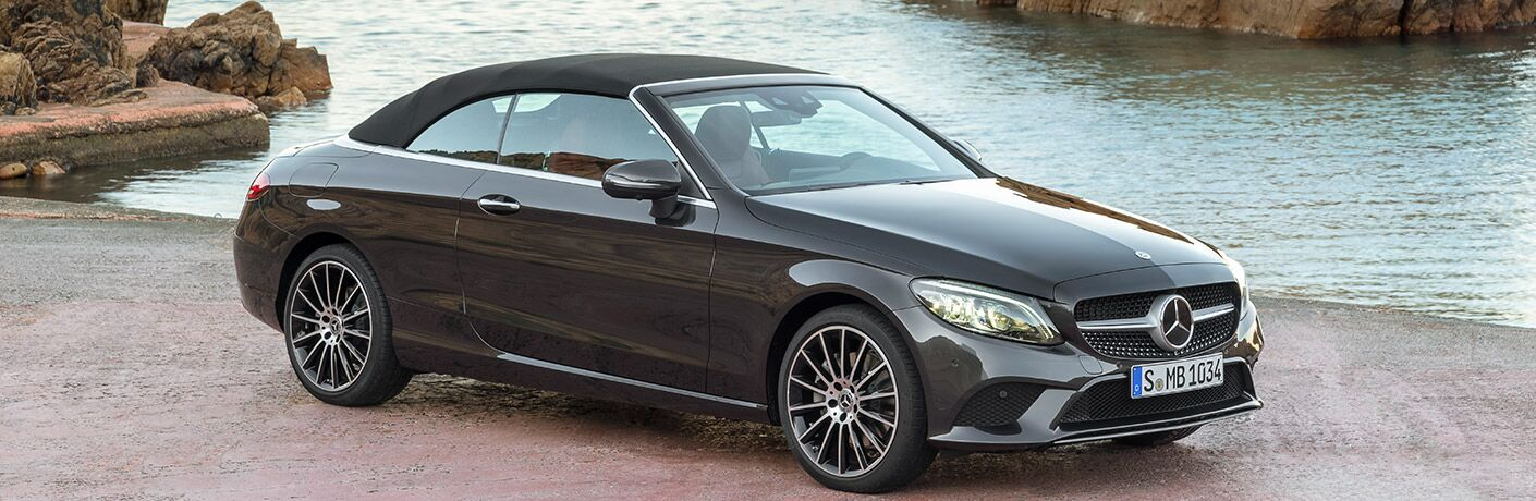 2019 Mercedes-Benz C-Class Cabriolet with the top up in front of water