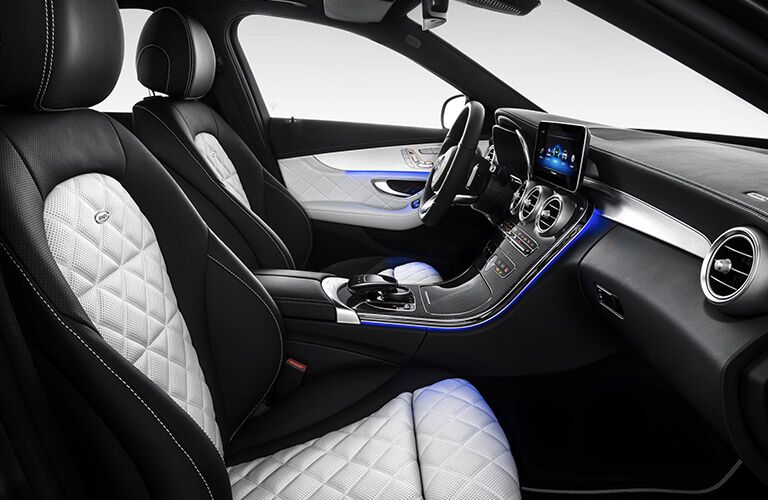 luxurious front seats of the 2019 Mercedes-Benz C-Class Sedan with blue ambient lighting