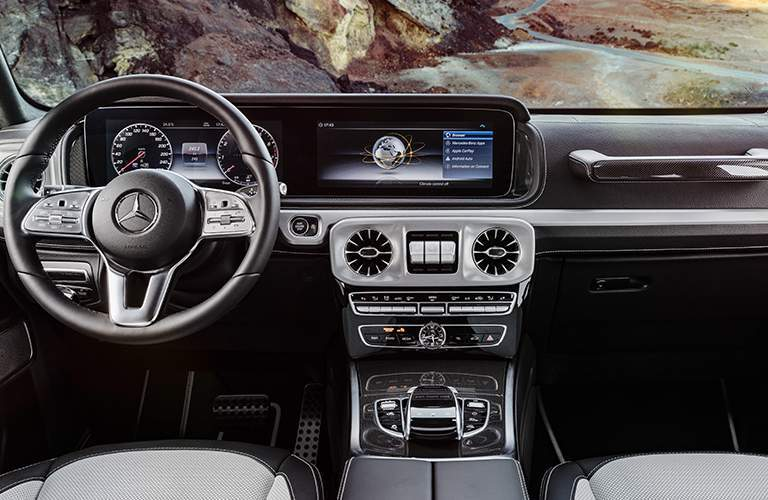 steering wheel and twin 12.3-inch display screens in the dashboard of the 2019 Mercedes-Benz G-Class