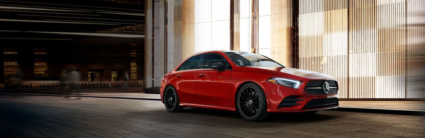 red 2019 mercedes-benz a-class parked in front of building at night