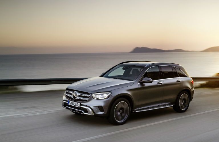2020 mb glc driving in front of a sunset