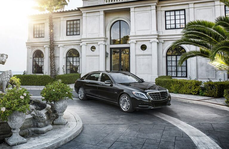2017 mb s class sedan in front of nice home