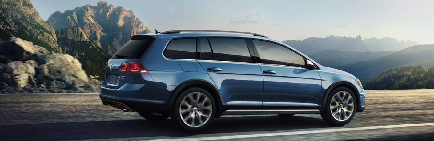 A right profile view of the 2108 Volkswagen Golf Alltrack driving on a mountain road