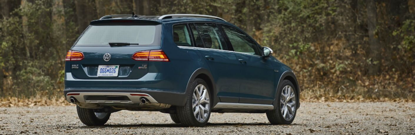 A rear right quarter photo of the 2018 Volkswagen Golf Alltrack parked in the woods.