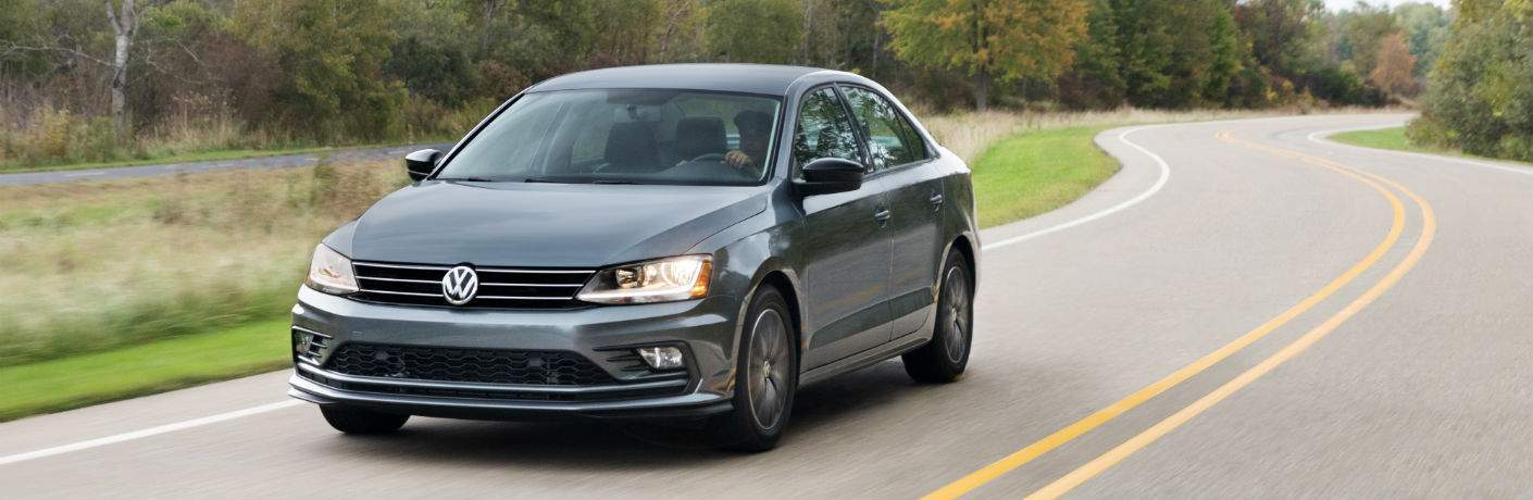 a front quarter view of the 2018 Volkswagen Jetta driving on a country road