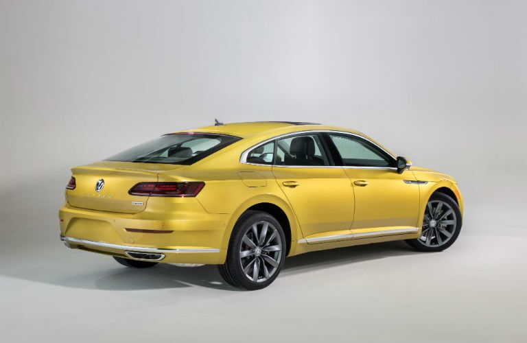 A rear right quarter photo of the 2019 VW Arteon in a photo studio.