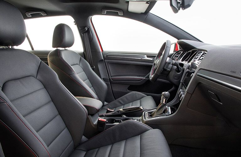 An interior photo of the 2018 VW Golf GTI showing the driver and front passenger seats.