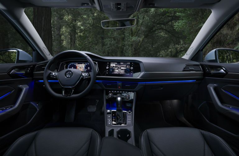 An interior photo of the 2019 VW Jetta showing its ambient lighting options and other technology.