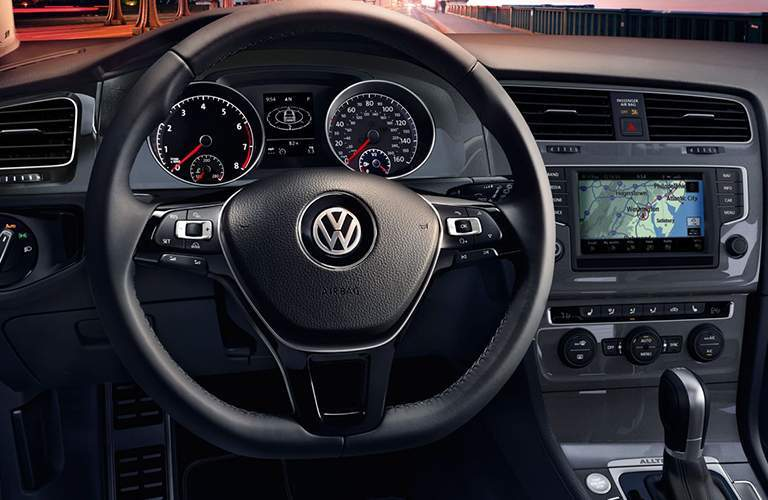 An interior photo of the 2018 VW Golf Alltrack SEL showing the driver's cockpit and navigation system