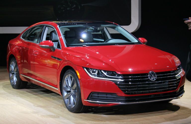 A front right quarter photo of a red 2019 VW Arteon at the Chicago Auto Show