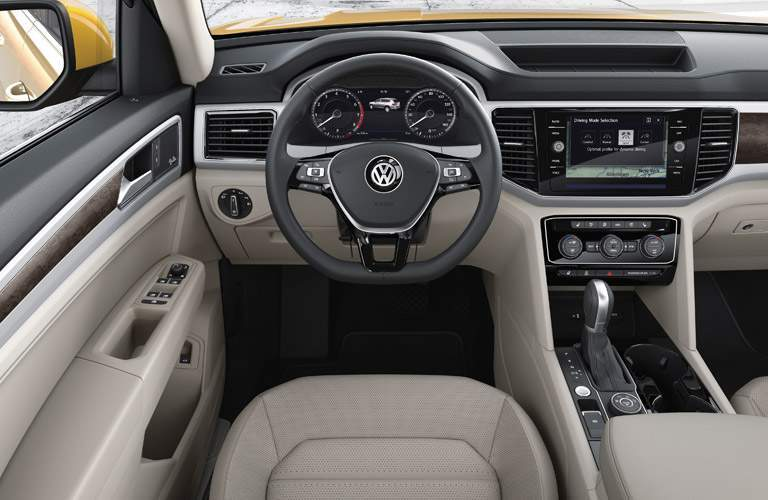 An interior photo of the 2018 VW Atlas showing the steering wheel, center gauge cluster and infotainment system touchscreen